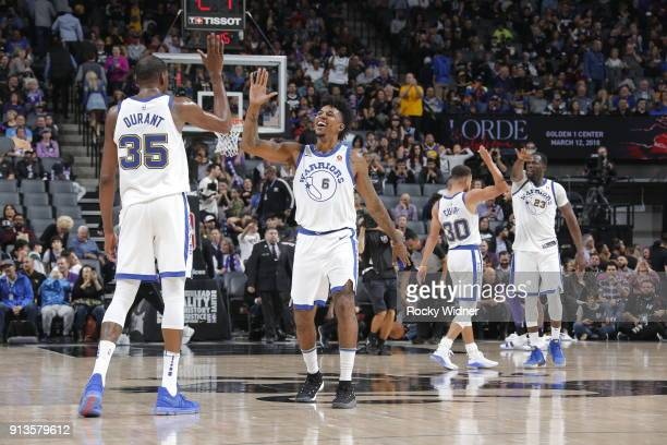 Kevin Durant and Nick Young of the Golden State Warriors exchange high fives during the game against the Sacramento Kings on February 2 2018 at...