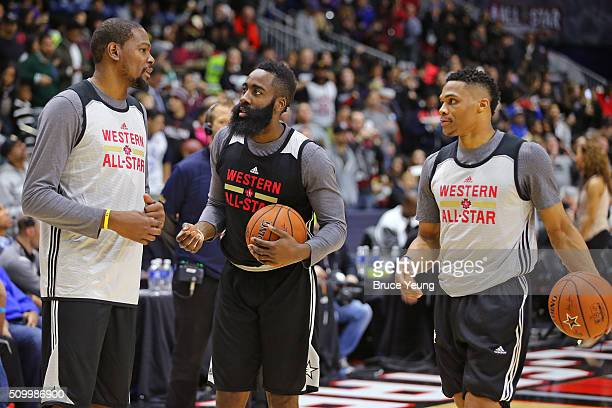 Kevin Durant and Oklahoma City Thunder talk to James Harden of the Houston Rockets during the NBA AllStar Practice as part of 2016 AllStar Weekend at...