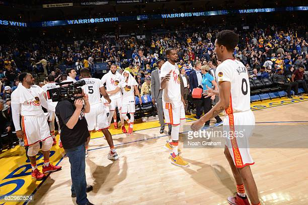 Kevin Durant and Patrick McCaw of the Golden State Warriors celebrate a win against the LA Clippers on January 28 2017 at ORACLE Arena in Oakland...