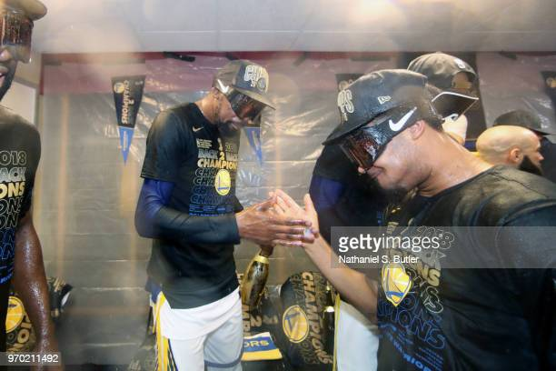 Kevin Durant and Quinn Cook of the Golden State Warriors celebrate after Game Four of the 2018 NBA Finals against the Cleveland Cavaliers on June 8...