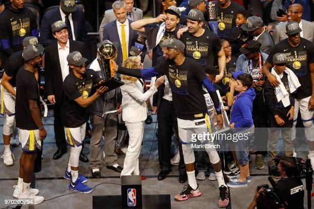 Kevin Durant and Quinn Cook of the Golden State Warriors celebrates with the Larry O'Brien Championship Trophy on stage after winning Game Four of...