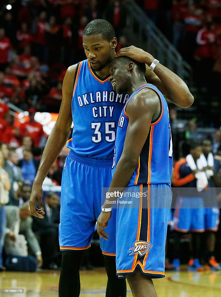Kevin Durant #35 and Reggie Jackson #15 of the Oklahoma City Thunder wait on the court late in the game against the Houston Rockets in Game Six of the Western Conference Quarterfinals of the 2013 NBA Playoffs at the Toyota Center on May 3, 2013 in Houston, Texas.