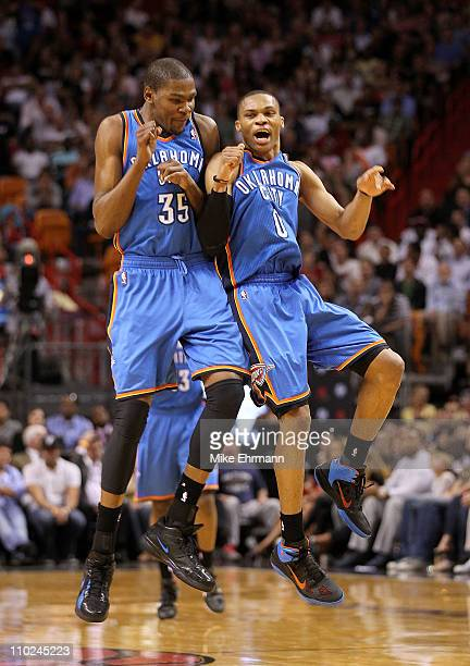 Kevin Durant and Russell Westbrook of the Oklahoma City Thunder celebrate after a 3 pointer during a game against the Miami Heat at American Airlines...