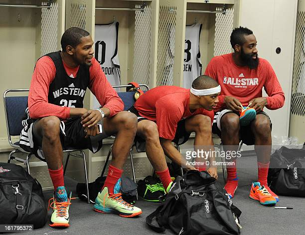 Kevin Durant and Russell Westbrook of the Oklahoma City Thunder and James Harden of the Houston Rockets sit at there lockers during the NBA AllStar...