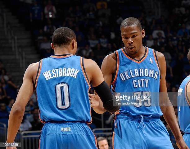 Kevin Durant and Russell Westbrook of the Oklahoma City Thunder greet each other prior to the game against the Orlando Magic on February 25 2011 at...