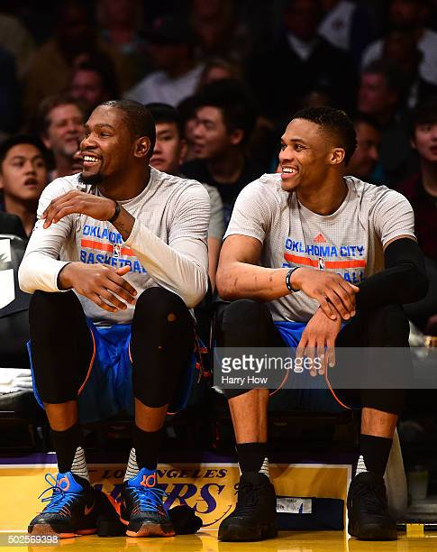 Kevin Durant and Russell Westbrook of the Oklahoma City Thunder laugh while on the bench for the fourth quarter during a 12085 win over the Los...