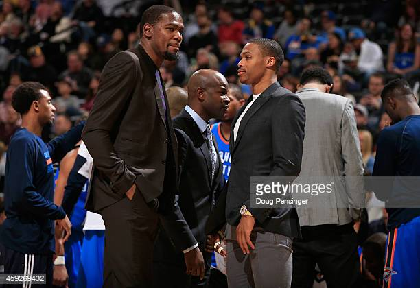 Kevin Durant and Russell Westbrook of the Oklahoma City Thunder look on from the bench as they sat out the game against the Denver Nuggets at Pepsi...