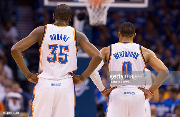Kevin Durant and Russell Westbrook of the Oklahoma City Thunder look on against the San Antonio Spurs in Game 4 of the Western Conference Finals...