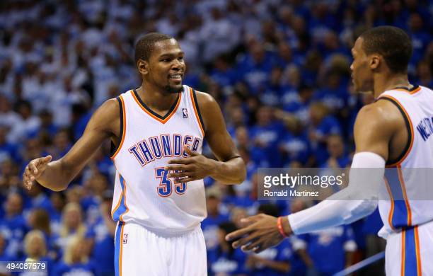 Kevin Durant and Russell Westbrook of the Oklahoma City Thunder react after a play in the third quarter against the San Antonio Spurs during Game...