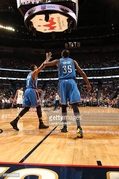 Kevin Durant and Russell Westbrook of the Oklahoma City Thunder shake hands against the New Orleans Pelicans during the game on December 2 2014 at...