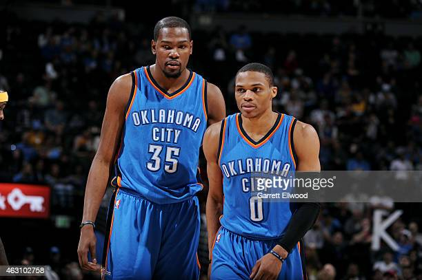 Kevin Durant and Russell Westbrook of the Oklahoma City Thunder stand on the court during a game against the Denver Nuggets on February 9 2015 at...