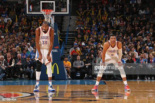 Kevin Durant and Russell Westbrook of the Oklahoma City Thunder stand on the court during the game against the Washington Wizards on February 1 2016...