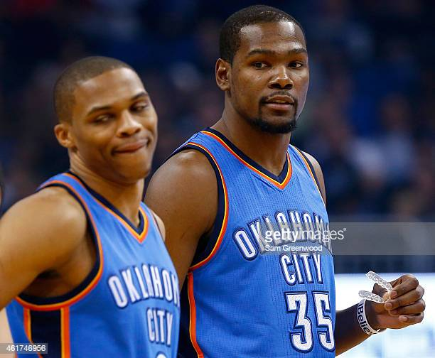 Kevin Durant and Russell Westbrook of the Oklahoma City Thunder wait during the game against the Orlando Magic at Amway Center on January 18 2015 in...