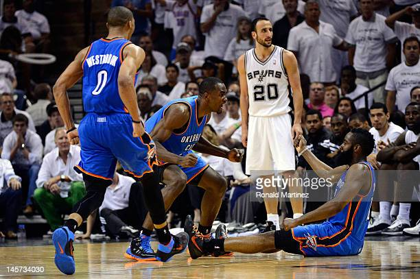 Kevin Durant and Russell Westbrook reacts after a play by James Harden of the Oklahoma City Thunder as Manu Ginobili of the San Antonio Spurs looks...