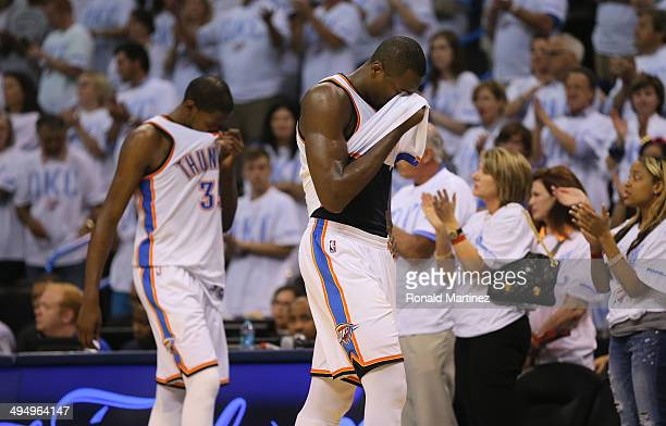 Kevin Durant and Serge Ibaka of the Oklahoma City Thunder walk off the court after the San Antonio Spurs defeated the Thunder 112107 in overtime...