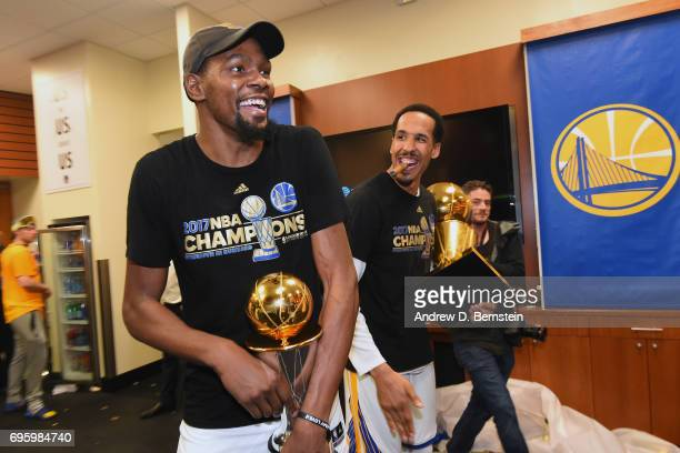 Kevin Durant and Shaun Livingston of the Golden State Warriors celebrate in the locker room after winning the NBA Championshiop against the Cleveland...