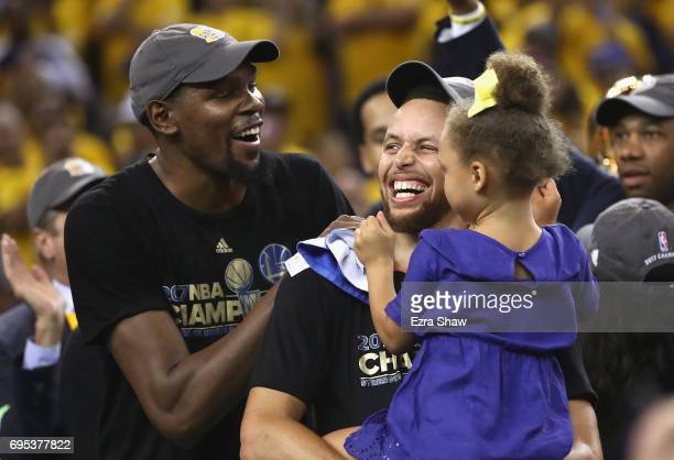 Kevin Durant and Stephen Curry of the Golden State Warriors celebrate after defeating the Cleveland Cavaliers 129120 in Game 5 to win the 2017 NBA...