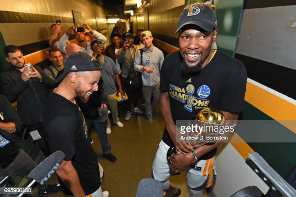 Kevin Durant and Stephen Curry of the Golden State Warriors celebrate in the hallway after winning the NBA Championship in Game Five of the 2017 NBA...