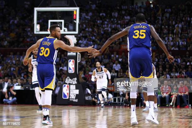 Kevin Durant and Stephen Curry of the Golden State Warriors celebrate during the game between the Minnesota Timberwolves and the Golden State...