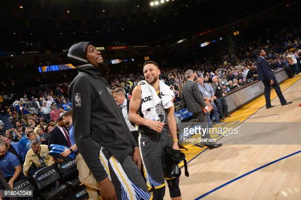 Kevin Durant and Stephen Curry of the Golden State Warriors celebrate a win against the Dallas Mavericks on February 8 2018 at ORACLE Arena in...