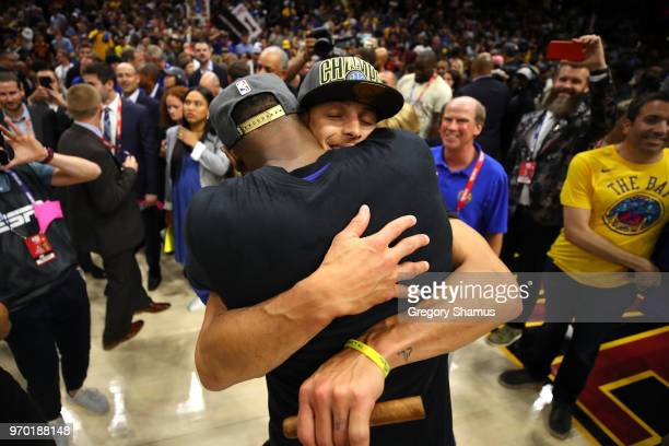 Kevin Durant and Stephen Curry of the Golden State Warriors celebrate after defeating the Cleveland Cavaliers during Game Four of the 2018 NBA Finals...