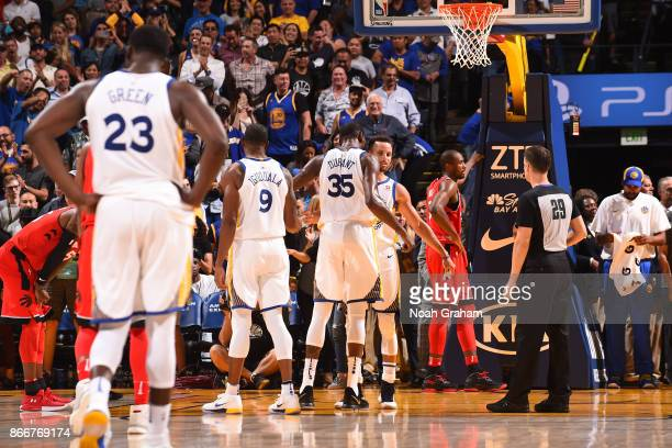 Kevin Durant and Stephen Curry of the Golden State Warriors chest bump during the game against the Toronto Raptors on October 25 2017 at ORACLE Arena...