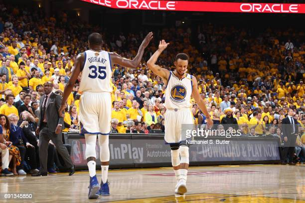 Kevin Durant and Stephen Curry of the Golden State Warriors high five during the game against the Cleveland Cavaliers in Game One of the 2017 NBA...