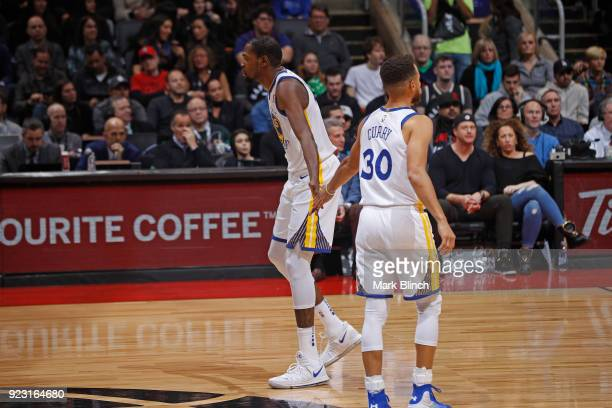 Kevin Durant and Stephen Curry of the Golden State Warriors high five during the game against the Toronto Raptors on January 13 2018 at the Air...