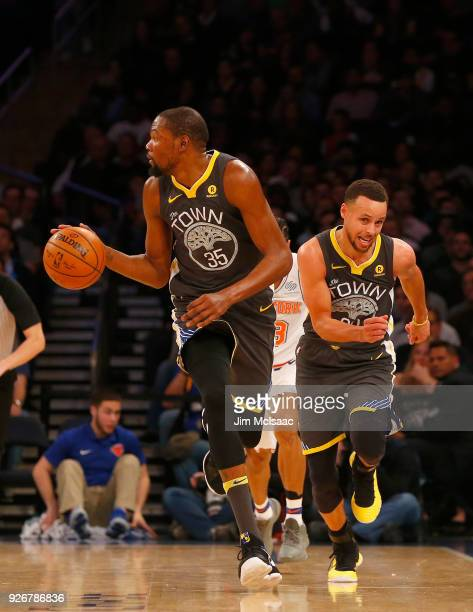 Kevin Durant and Stephen Curry of the Golden State Warriors in action against the New York Knicks at Madison Square Garden on February 26 2018 in New...