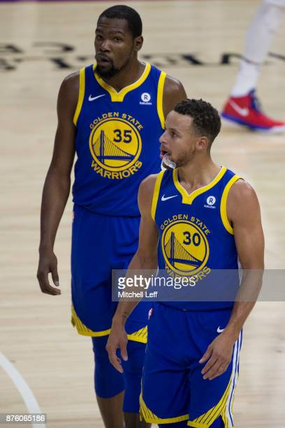 Kevin Durant and Stephen Curry of the Golden State Warriors look on in the second quarter against the Philadelphia 76ers at the Wells Fargo Center on...