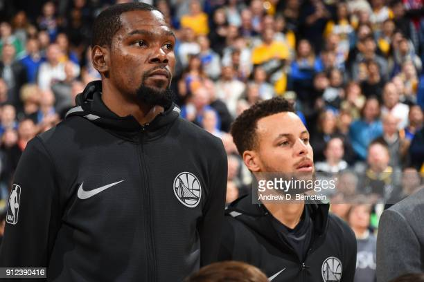 Kevin Durant and Stephen Curry of the Golden State Warriors look on prior to the game against the Boston Celtics on January 27 2018 at ORACLE Arena...