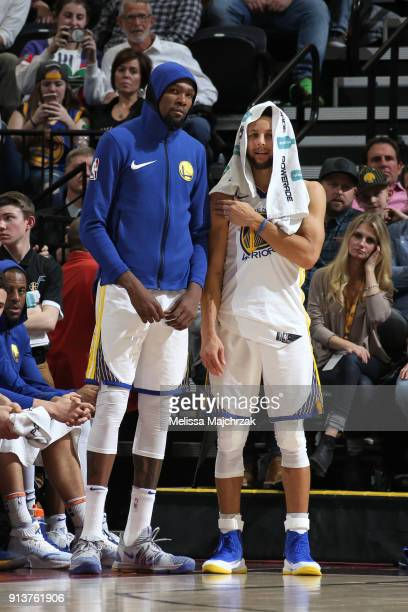 Kevin Durant and Stephen Curry of the Golden State Warriors look on during the game against the Utah Jazz at vivintSmartHome Arena on January 20 2018...