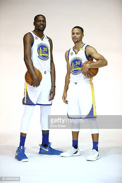 Kevin Durant and Stephen Curry of the Golden State Warriors pose for NBA team photographer Noah Graham during the Golden State Warriors Media Day at...