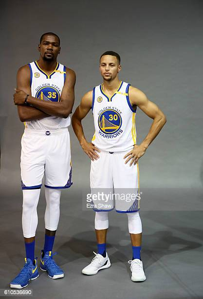 Kevin Durant and Stephen Curry of the Golden State Warriors pose for San Francisco Chronicle photographer Russell Yip during the Golden State...