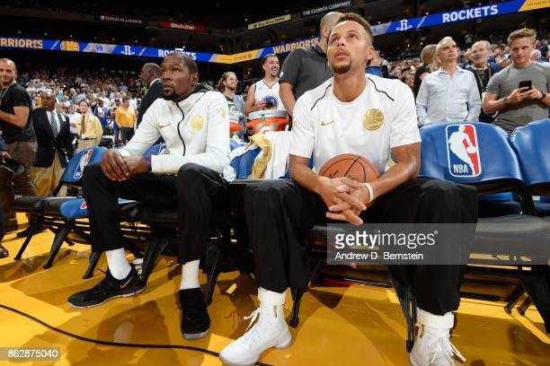Kevin Durant and Stephen Curry of the Golden State Warriors sit on the bench before the game against the Houston Rockets on October 17 2017 at ORACLE...