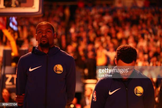 Kevin Durant and Stephen Curry of the Golden State Warriors stand for the National Anthem before their game against the New York Knicks at ORACLE...