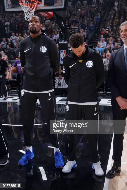 Kevin Durant and Stephen Curry of the Golden State Warriors stand for the national anthem of the game against the Sacramento Kings on February 2 2018...