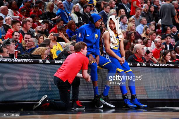 Kevin Durant and Stephen Curry of the Golden State Warriors wait to get in the game against the Chicago Bulls on January 17 2018 at the United Center...