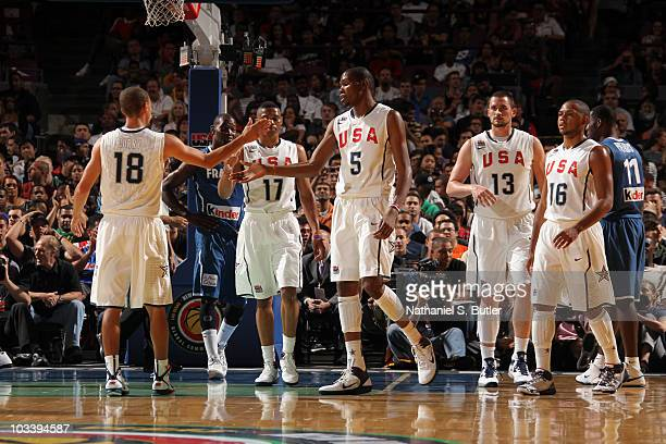 Kevin Durant and Stephen Curry of the USA Men's National Team team high five each other against France at Madison Square Garden on August 15, 2010 in...