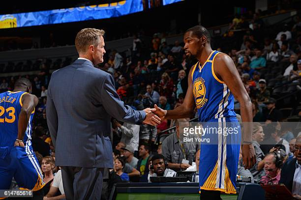 Kevin Durant and Steve Kerr of the Golden State Warriors shake hands before a preseason game against the Denver Nuggets on October 14 2016 at the...