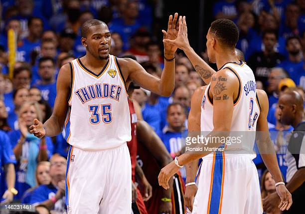 Kevin Durant and Thabo Sefolosha of the Oklahoma City Thunder give each other a high five in the third quarter in Game One of the 2012 NBA Finals at...