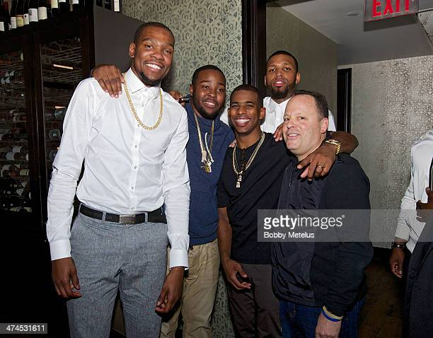Kevin Durant Chris Paul and Leon Rose are seen during NBA AllStar Weekend 2014 at on February 15 2014 in New Orleans Louisiana