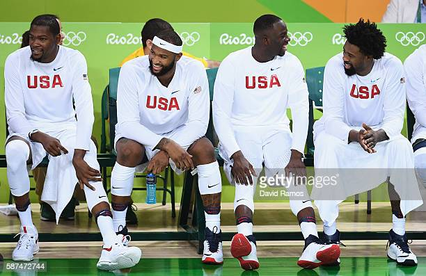 Kevin Durant DeAndre Jordan Draymond Green and DeAndre Jordan of United States laugh on the bench near the end of regulation in a win during the...