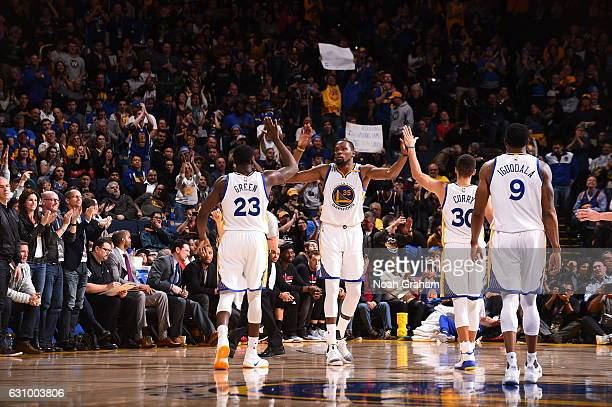 Kevin Durant Draymond Green Stephen Curry and Andre Iguodala of the Golden State Warriors celebrate a win against the Portland Trail Blazers on...