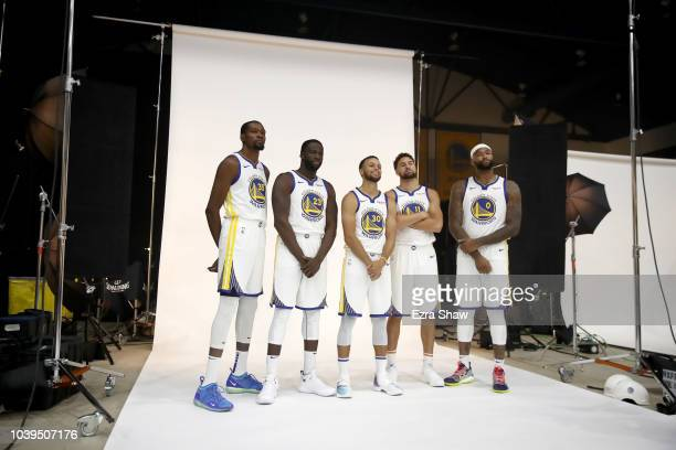 Kevin Durant Draymond Green Stephen Curry Klay Thompson and DeMarcus Cousins of the Golden State Warriors pose for a group picture during the Golden...