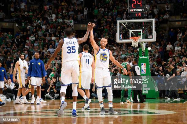 Kevin Durant high gives Stephen Curry of the Golden State Warriors during the game against the Boston Celtics on November 16 2017 at the TD Garden in...