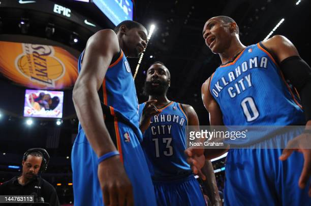 Kevin Durant James Harden and Russell Westbrook of the Oklahoma City Thunder gather together during their game against the Los Angeles Lakers in Game...