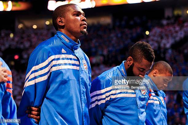 Kevin Durant James Harden and Russell Westbrook of the Oklahoma City Thunder listen to the National Anthem before facing the Miami Heat in Game Two...