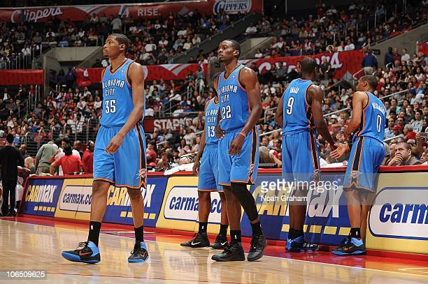 Kevin Durant James Harden Jeff Green Serge Ibaka and Russell Westbrook of the Oklahoma City Thunder look on against the Los Angeles Clippers at...