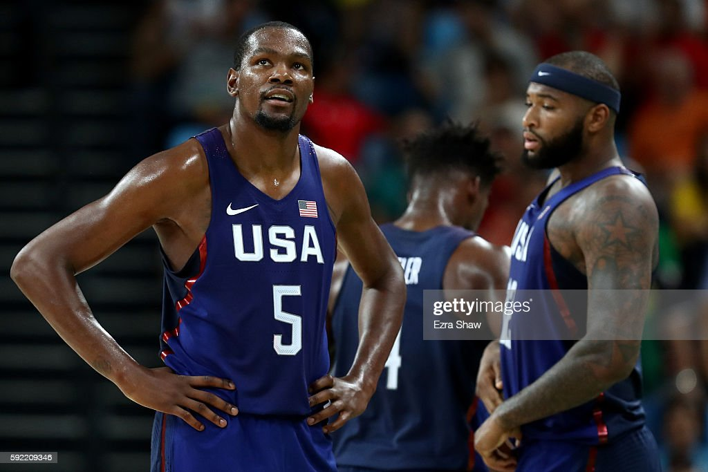 Kevin Durant #5, Jimmy Butler #4 and Demarcus Cousins #12 of United States react during the Men's Semifinal match against Spain on Day 14 of the Rio 2016 Olympic Games at Carioca Arena 1 on August 19, 2016 in Rio de Janeiro, Brazil.